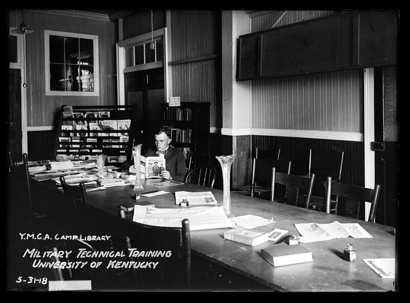 Man reading Red Cross Magazine at YMCA camp library at University of Kentucky, 1918