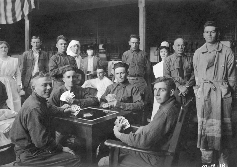 Convalescents playing cards in Gymnasium Hospital in Buell Armory during influenza epidemic, 17 October 1918