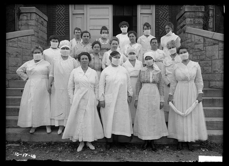 Nurses and aides on steps of Miller Hall, some with masks during flu epidemic, 1918